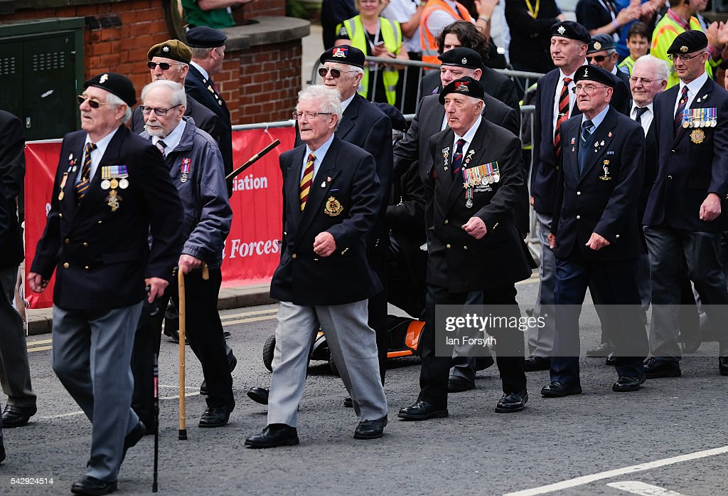 Veterans march past members of the public as they take part in the main military parade during the Armed Forces Day National Event on June 25, 2016 in Cleethorpes, England. The visit by the Prime Minister came the day after the country voted to leave the European Union. Armed Forces Day is an annual event that gives an opportunity for the country to show its support for the men and women in the British Armed Forces.