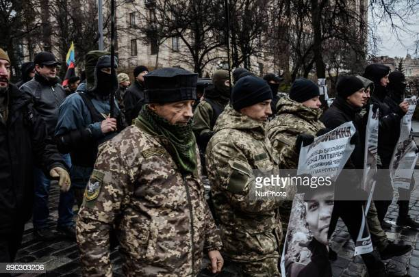 Veterans of an antiterrorists operation in eastern Ukraine during the march in Kiev Thousands of supporters of the oppositional leader and former...
