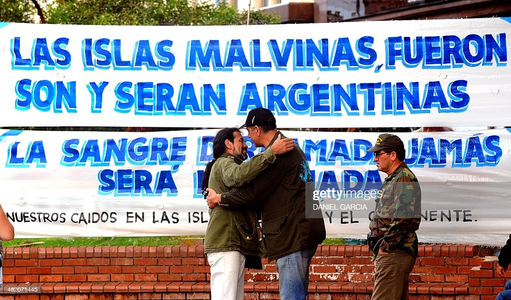 Veterans of the 1982 Falklands (Malvinas) War greet each other at Plaza de Mayo Square before participating in a ceremony to honor the soldiers who died in the South Atlantic conflict between Great Britain and Argentina, in Buenos Aires on April 2, 2014 during the elebration of the 32nd anniversary of the war.