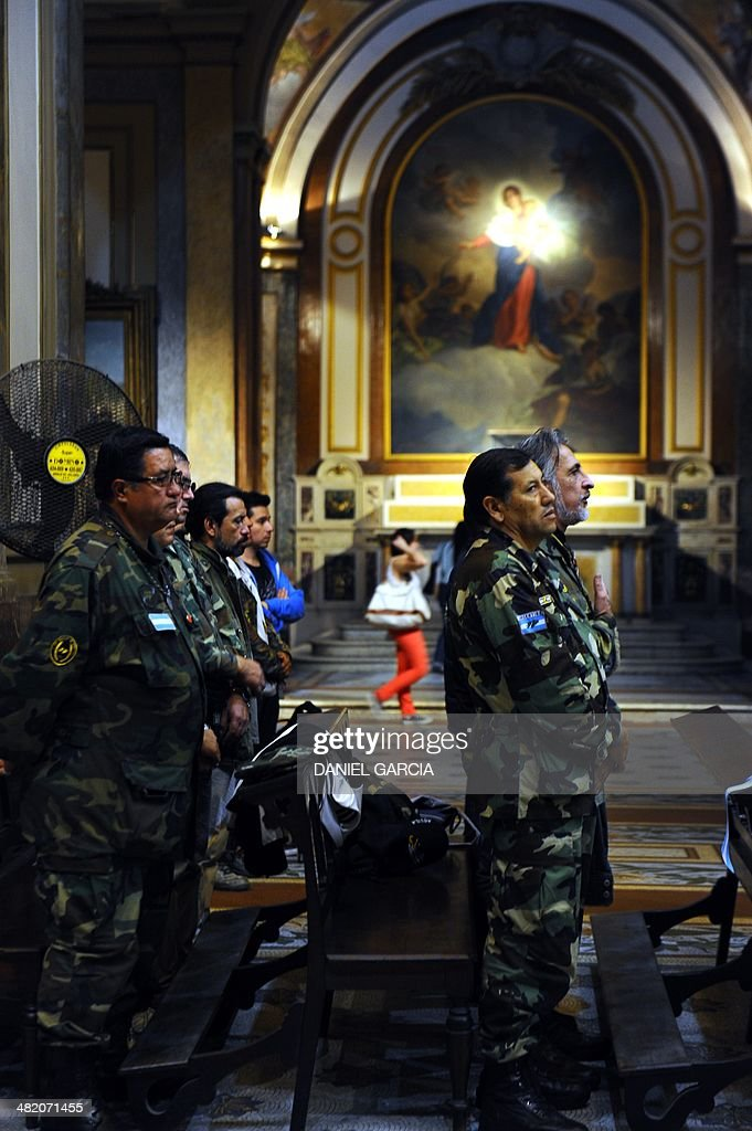 Veterans of the 1982 Falklands (Malvinas) War participate in a ceremony at the Cathedral to honor the soldiers who died in the South Atlantic conflict between Great Britain and Argentina, in Buenos Aires on April 2, 2014 during the elebration of the 32nd anniversary of the war.
