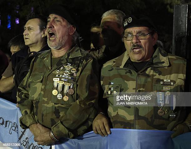 Veterans of the 1982 Falklands War sing the national anthem while taking part in a ceremony to honor the soldiers who died in the South Atlantic...