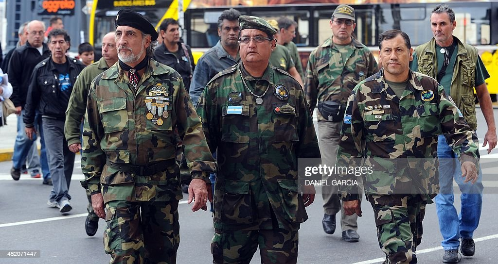 Veterans of the 1982 Falklands (Malvinas) War walk at Plaza de Mayo Square before participating in a ceremony to honor the soldiers who died in the South Atlantic conflict between Great Britain and Argentina, in Buenos Aires on April 2, 2014 during the elebration of the 32nd anniversary of the war.