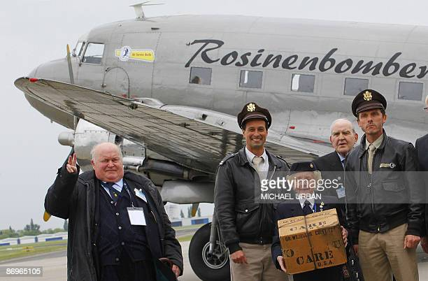Veterans of the Berlin airlift Bernard Howard Jane Steane and Dennis Boxhall from Britain pose in front of a vintage Douglas DC3 aircraft known as a...