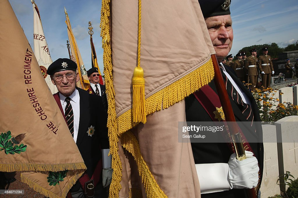 Veterans of the British Cheshire Regiment attend a commemoration ceremony at the village cemetery to honour members of the Cheshire Regiment and other soldiers who died fighting the German Army exactly 100 years before during World War I on August 24, 2014 in Audregnies, Belgium. Of the 25 officers and 925 men of the 1st Battalion, Cheshire Regiment who fought that day only a total of 207 would survive after two messengers with instructions for the unit to retreat failed to make it through. The battle came on the heals of the Battle of Mons the day before, which was the first major engagmement between British and German forces in the war. The British, French and Belgian armies were forced to continue their retreat until weeks later, when only a short distance from Paris they managed to reverse the tide of the war and push the Germans back north.