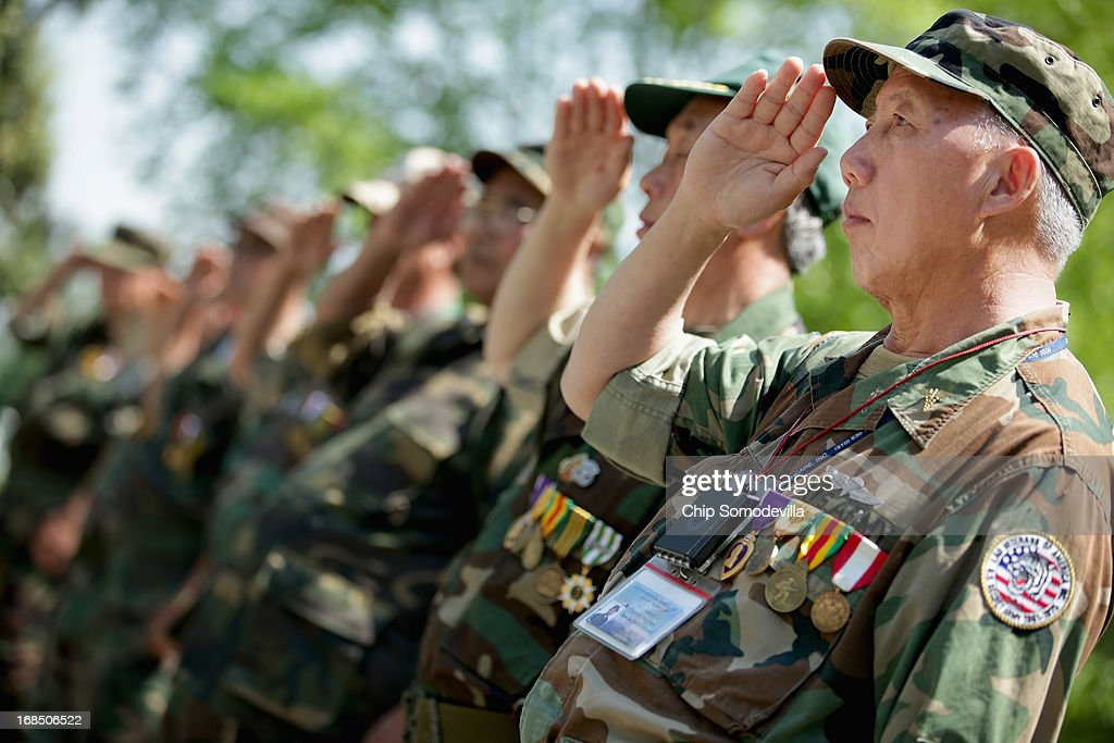 Veterans of the United States' secret Lao Theater, including Lt. Nyia Cheng Moua (R) of Stockton, California, salute during a memorial and wreath-laying ceremony at the plaque dedicated to the U.S. Secret Army in the Kingdom of Laos in Arlington National Cemetery May 10, 2013 in Arlington, Virginia. Supported by the United States and the Central Intelligence Agency from 1961 to 1973, the secret army of Hmong and Lao combat soldiers fought in the jungles of Southeast Asia during the Vietnam War.