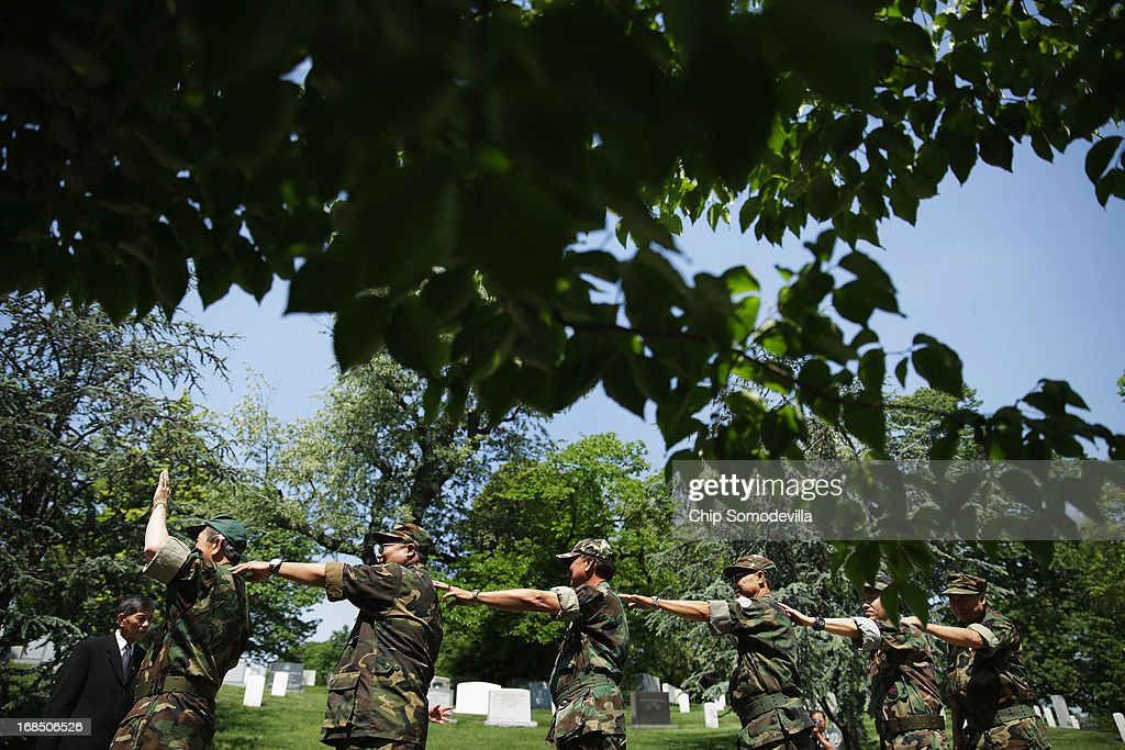 Veterans of the United States' secret Lao Theater, including Lt. Nyia Cheng Moua (L) of Stockton, California, prepare for a memorial and wreath-laying ceremony at the plaque dedicated to the U.S. Secret Army in the Kingdom of Laos in Arlington National Cemetery May 10, 2013 in Arlington, Virginia. Supported by the United States and the Central Intelligence Agency from 1961 to 1973, the secret army of Hmong and Lao combat soldiers fought in the jungles of Southeast Asia during the Vietnam War.