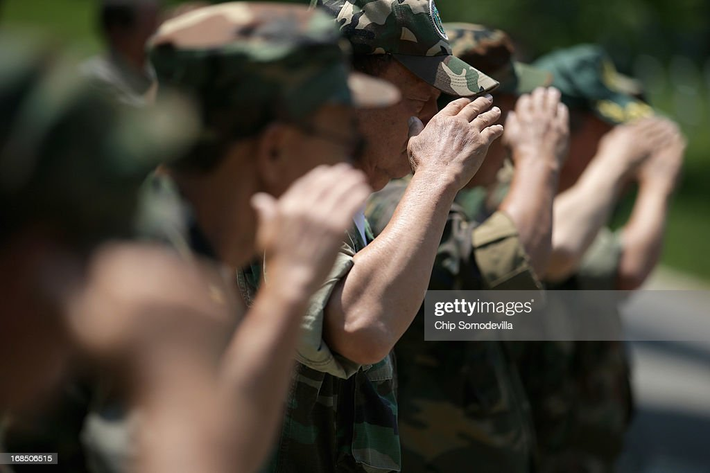 Veterans of the United States' secret Lao Theater salute during a memorial and wreath-laying ceremony at the plaque dedicated to the U.S. Secret Army in the Kingdom of Laos in Arlington National Cemetery May 10, 2013 in Arlington, Virginia. Supported by the United States and the Central Intelligence Agency from 1961 to 1973, the secret army of Hmong and Lao combat soldiers fought in the jungles of Southeast Asia during the Vietnam War.