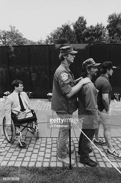 Veterans of the Vietnam War at the Vietnam Veterans Memorial in Washington DC circa 1987