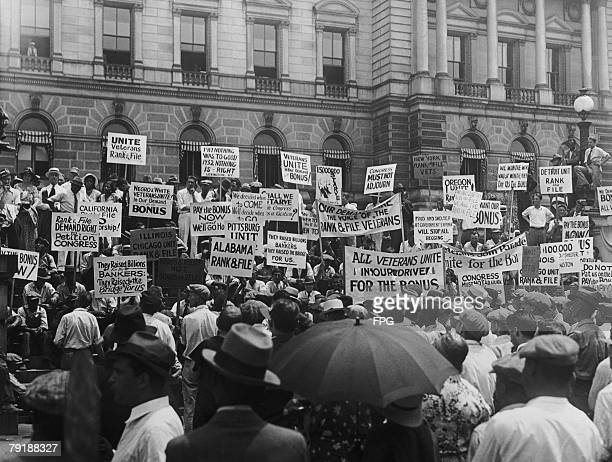 Veterans of World War I gather outside the Congressional Library in Washington to demand the immediate payment of a cash bonus promised to them eight...