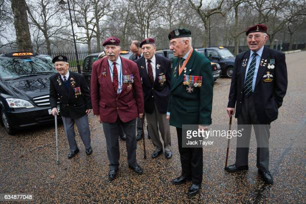 Veterans of World War II gather in front of black cabs during a photo call for the launch of the Veterans Black Cab ride at Wellington Barracks on...