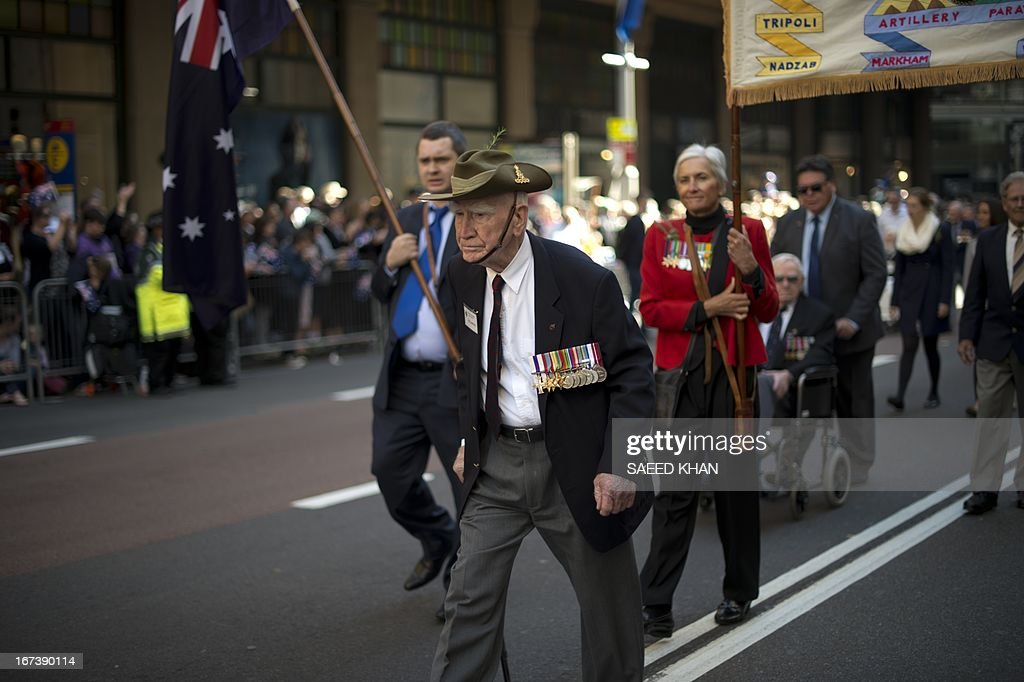 Veterans participate in the Anzac Day march in Sydney on April 25, 2013. Tens of thousands of Australians and New Zealanders turned out on April 25 to honour their war dead, with moving tributes to fallen mates and calls not to forget those injured in conflict. AFP PHOTO / Saeed Khan