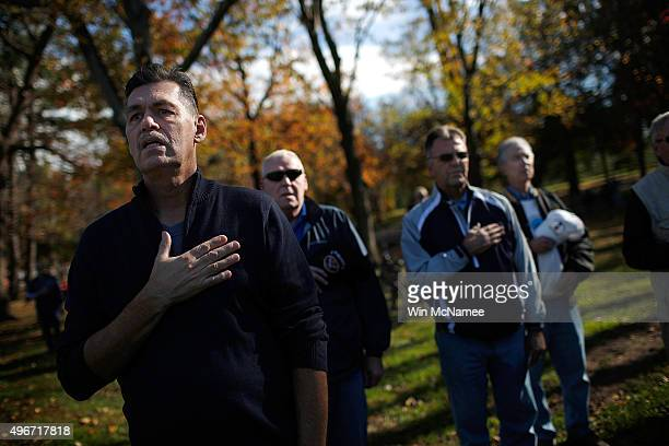 S veterans recite the Pledge of Allegiance during a Veterans Day observance at the Vietnam Veterans Memorial November 11 2015 in Washington DC...