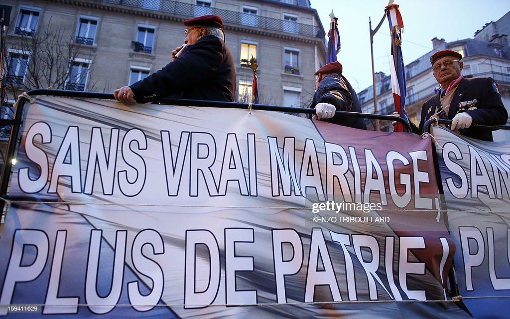 Veterans stand beside a banner reading in French 'Without marriage, no more homeland' as they take part in a protest against same-sex marriage on January 13, 2013 in Paris. Tens of thousands march in Paris on January 13 to denounce government plans to legalise same-sex marriage and adoption which have angered many Catholics and Muslims, France's two main faiths, as well as the right-wing opposition. The French parliament is to debate the bill -- one of the key electoral pledges of Socialist President -- at the end of this month. AFP PHOTO / KENZO TRIBOUILLARD