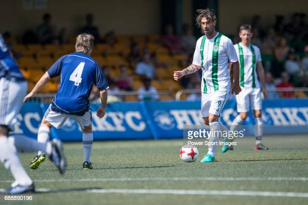 Veterans's Allan Mcmanus competes with HKFC Chairman's Select's Ashley Dyer for a ball during their Masters Tournament match part of the HKFC Citi...