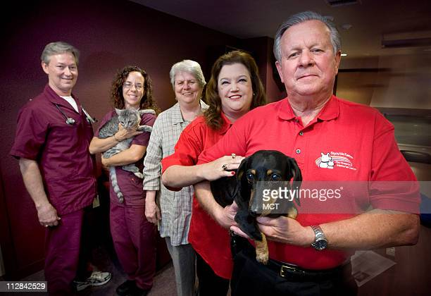 Veterinarian Randy Jones from left hospice nurse Vicky McPhee holding Eli the clinic cat chaplain Rev Anita Westmoreland Kate Moore and Terry Branson...