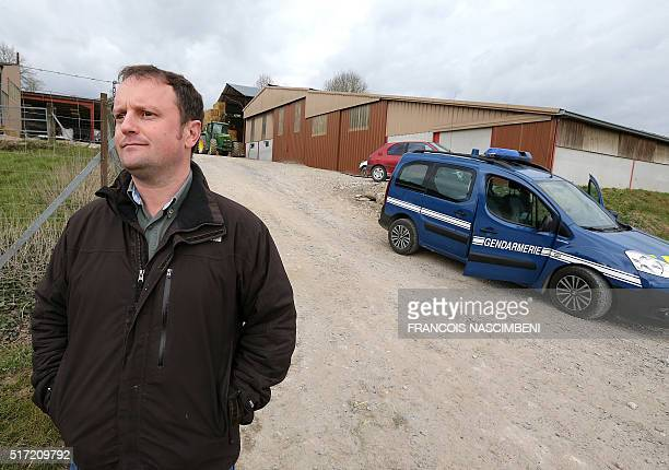 Veterinary physician Sebastien Janmart poses outside a farm where a case of mad cow disease was found in Givron in the northeastern region of...