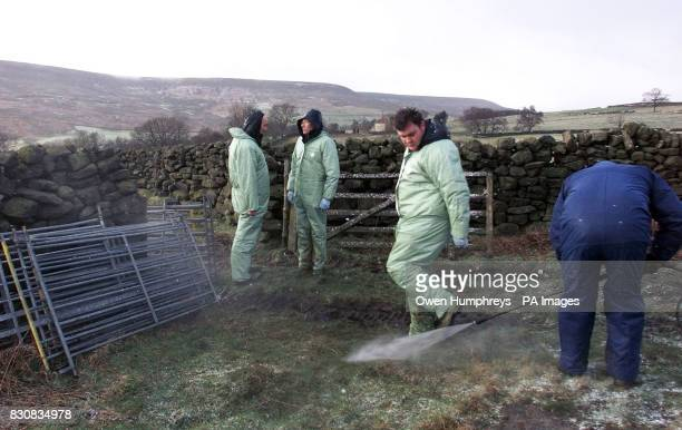 DEFRA vets are washed down after testing more sheep on the North Yorkshire Moors near the farm in Hawnby near Thirsk after Initial results of...