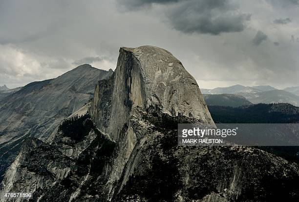 Vew of the Half Dome monolith from Glacier Point at the Yosemite National Park in California on June 4 2015 At first glance the spectacular beauty of...