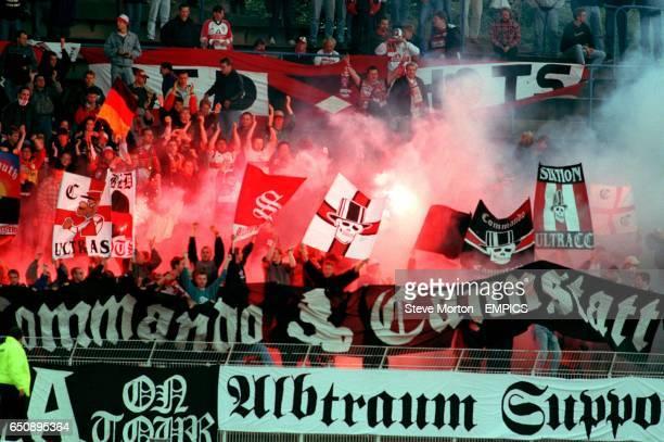 VfB Stuttgart fans let off flares in the crowd