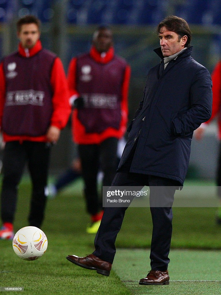 VfB Stuttgart head coach Bruno Labbadia kicks the ball during the UEFA Europa League Round of 16 second leg match between S.S. Lazio and VfB Stuttgart at Stadio Olimpico on March 14, 2013 in Rome, Italy.
