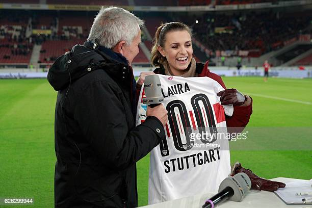 VfB Stuttgart President Wolfgang Dietrich hands over flowers and a jersey to Sport1 TV host Laura Wontorra prior to the Second Bundesliga match...