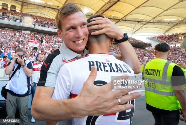VfB Stuttgart's head coach Hannes Wolf and Croatian forward Josip Brekalo celebrate after the German second division Bundesliga football match VfB...