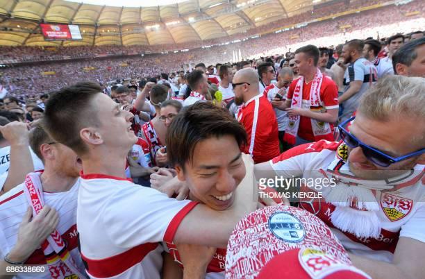 VfB Stuttgart's Japanese forward Takuma Asano is celebrated by fans after the German second division Bundesliga football match VfB Stuttgart v FC...
