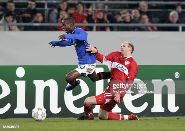 VfB Stuttgart's Ludovic Magnin and Rangers' DaMarcus Beasley battle for the ball