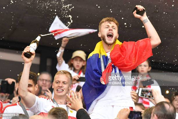 VfB Stuttgart's Romanian midfielder Alexandru Maxim and defender Timo Baumgartl celebrate celebrate after the German second division Bundesliga...