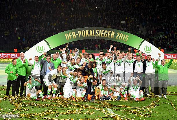 VfL Wolfsburg celebrate with the trophy after their victory in the DFB Cup Final match between Borussia Dortmund and VfL Wolfsburg at Olympiastadion...