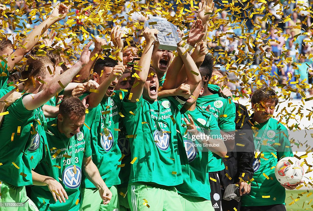 VfL Wolfsburg celebrate with the trophy after winning the A Juniors Bundesliga final match between FC Hansa Rostock and VfL Wolfsburg at DKB-Arena on June 23, 2013 in Rostock, Germany.