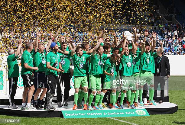 VfL Wolfsburg celebrate with the trophy after winning the A Juniors Bundesliga final match between FC Hansa Rostock and VfL Wolfsburg at DKBArena on...