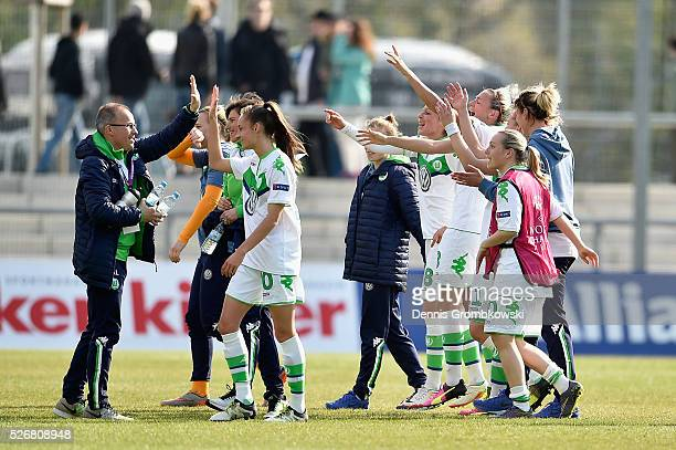 VfL Wolfsburg players celebrate victory in the UEFA Women's Champions League Semi Final second leg match between 1 FFC Frankfurt and VfL Wolfsburg at...