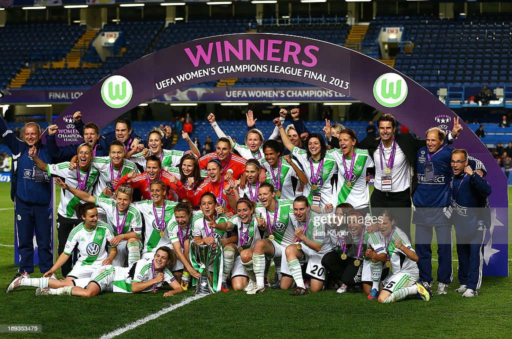 VfL Wolfsburg players celebrate with the trophy after winning the UEFA Women's Champions League final match between VfL Wolfsburg and Olympique Lyonnais at Stamford Bridge on May 23, 2013 in London, England.