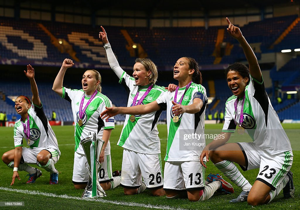 VfL Wolfsburg playes celebrate with the trophy after winning the UEFA Women's Champions League final match between VfL Wolfsburg and Olympique Lyonnais at Stamford Bridge on May 23, 2013 in London, England.