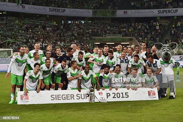 VfL Wolfsburg team celebrates after the DFL Supercup 2015 match between VfL Wolfsburg and FC Bayern Muenchen at Volkswagen Arena on August 1 2015 in...