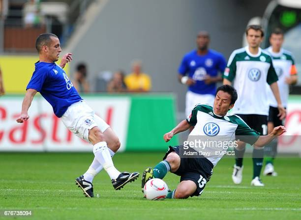 Vfl Wolfsburg's Makoto Hasebe slides in to tackle Everton's Leon Osman