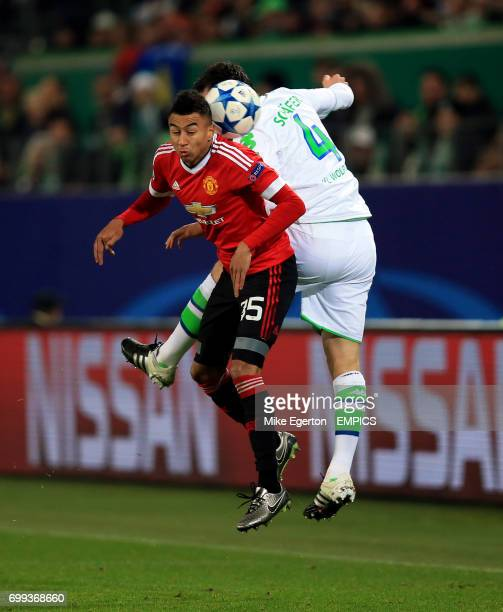 VfL Wolfsburg's Marcel Schafer and Manchester United's Jesse Lingard battle for the ball