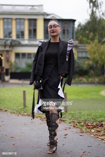 Vhu is seen attending Manish Arora during Paris Fashion Week wearing a black outfit with ruffled accents on September 28 2017 in Paris France