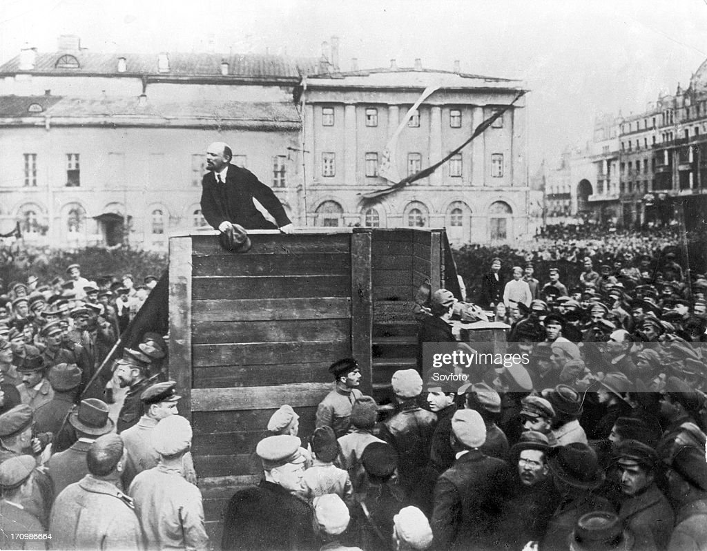 V,i, lenin speaking to red army troops leaving for the front (civil war period), sverdlov square, moscow, may 5th 1920, this is an altered image: the figure of leon trotsky standing in the area with steps behind the speakers' platform has been painted out.