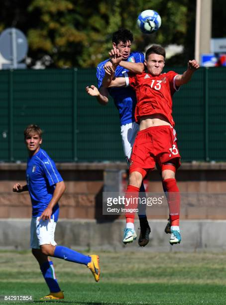 Viacheslav Grulev of Russia U19 competes for the ball with Alessandro Bastoni of Italy U19 during the match between Italy U19 and Russia U19 at...