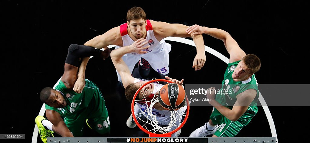 Viacheslav Kravtsov #15 of CSKA Moscow competes with Marcus Slaughter #42 of Darussafaka Dogus Istanbul during the Turkish Airlines Euroleague...
