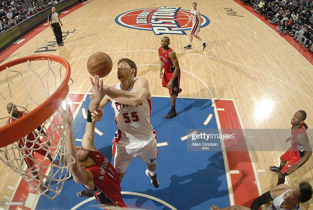 Viacheslav Kravtsov of the Detroit Pistons and Jonas Valanciunas of the Toronto Raptors batte for the ball control during the game between the...