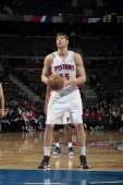 Viacheslav Kravtsov of the Detroit Pistons attempts a foul shot against the Minnesota Timberwolves during the game on March 26 2013 at The Palace of...