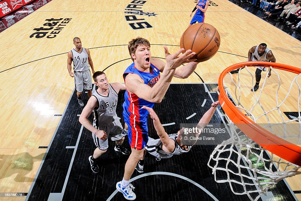 Viacheslav Kravtsov #55 of the Detroit Pistons drives to the basket against the San Antonio Spurs on March 3, 2013 at the AT&T Center in San Antonio, Texas.