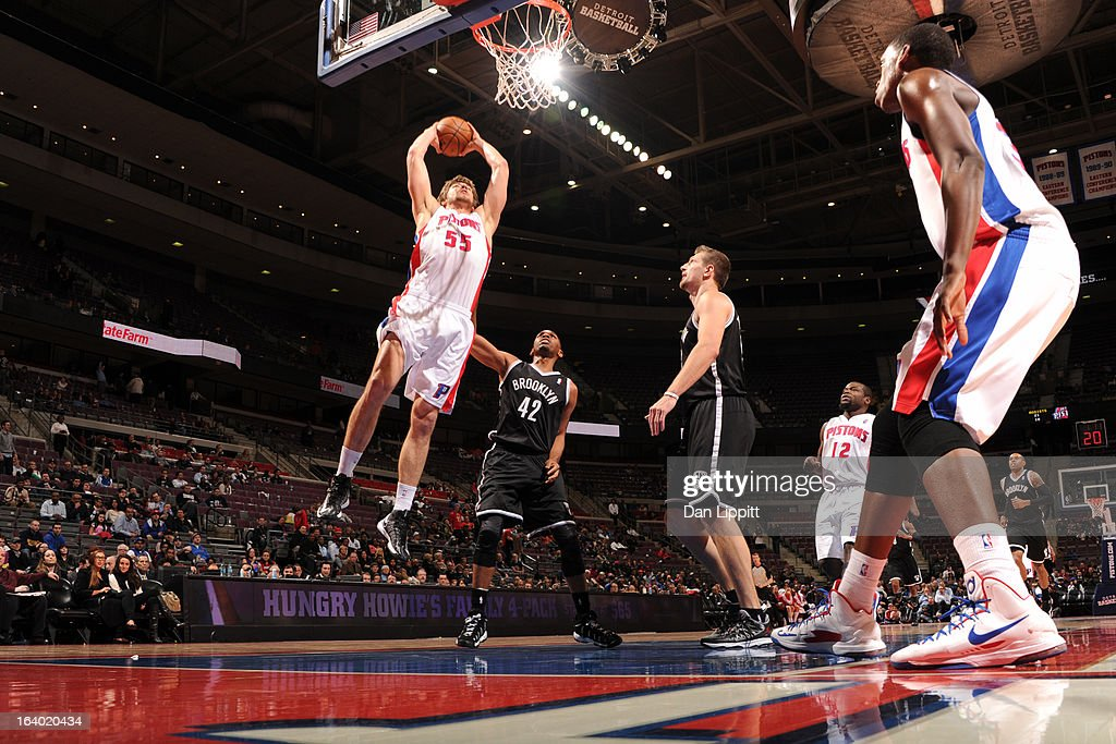 Viacheslav Kravtsov of the Detroit Pistons dunks against Jerry Stackhouse of the Brooklyn Nets on March 18 2013 at The Palace of Auburn Hills in...
