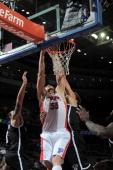 Viacheslav Kravtsov of the Detroit Pistons dunks the ball against the Brooklyn Nets on February 6 2013 at The Palace of Auburn Hills in Auburn Hills...