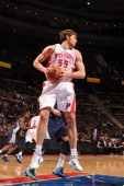Viacheslav Kravtsov of the Detroit Pistons grabs the rebound against the Memphis Grizzlies on February 19 2013 at The Palace of Auburn Hills in...