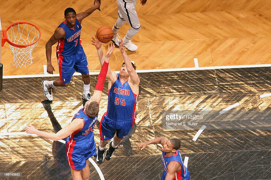 Viacheslav Kravtsov #55 of the Detroit Pistons reaches for a rebound against the Brooklyn Nets on April 17, 2013 at the Barclays Center in the Brooklyn borough of New York City.
