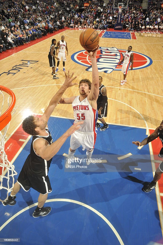 Viacheslav Kravtsov #55 of the Detroit Pistons shoots against <a gi-track='captionPersonalityLinkClicked' href=/galleries/search?phrase=Brook+Lopez&family=editorial&specificpeople=3847328 ng-click='$event.stopPropagation()'>Brook Lopez</a> #11 of the Brooklyn Nets on February 6, 2013 at The Palace of Auburn Hills in Auburn Hills, Michigan.